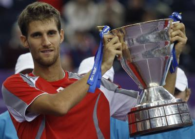 Klizan of Slovakia holds the trophy after defeating Fognini of Italy in the men's singles final at the St. Petersburg Open tennis tournament
